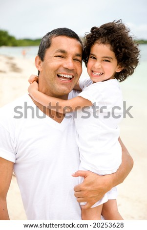 father and son having fun at the beach