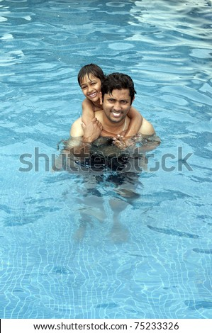Father and Son having fun at  the resport pool
