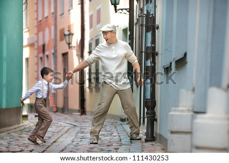 Father and son having fun outdoors in city