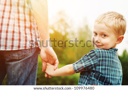 Father and son holding hand in hand #109976480