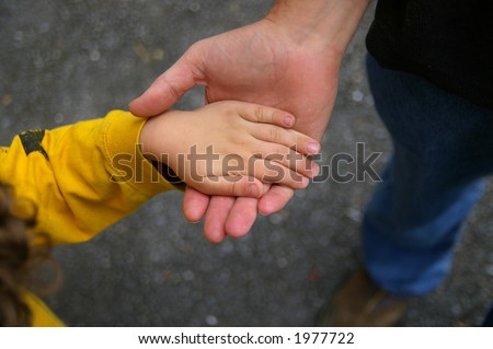 father and son holding hands. stock photo : Father and son