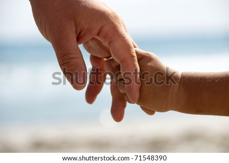 Father and son holding hands