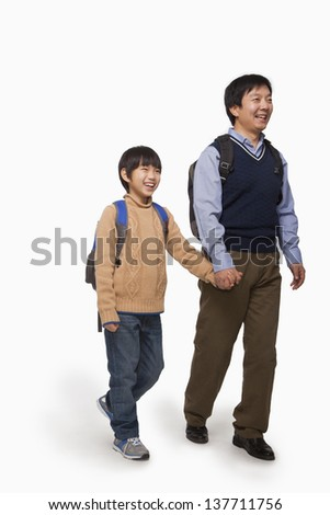Father and son holding hands and walking