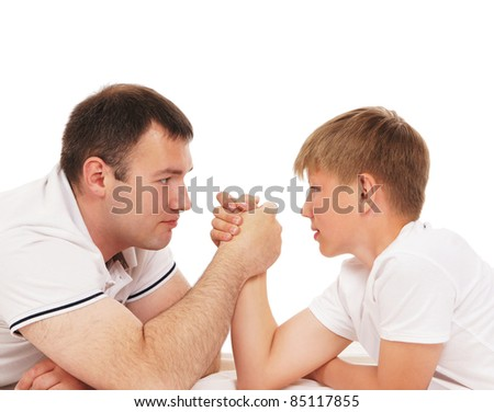 Father and son in arm-wrestling competition isolated over white background