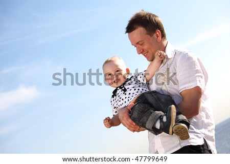 father and son in blue sky