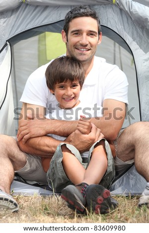 Father and son in front of their tent