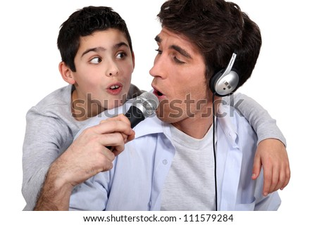 father and son listening music and singing