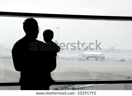 father and son looking at airplanes - stock photo