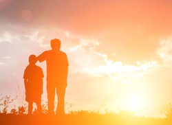 Father and son looking for future,  silhouette concept