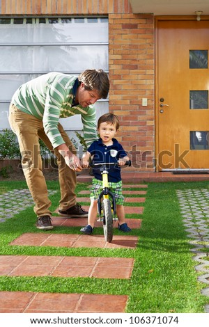 Father and son moment: Father teaching his son how to ride a bike