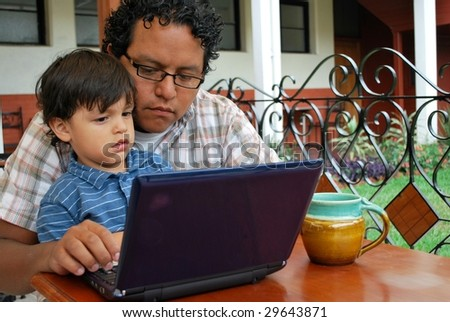 Father and son on computer together