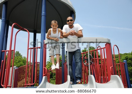 Father and Son on Playground Equipment Two Generation Family