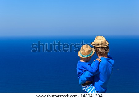 father and son on sea vacation