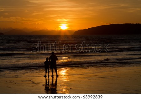 father and son on sunset