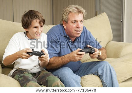 Father and son or uncle and nephew, playing video games at home.