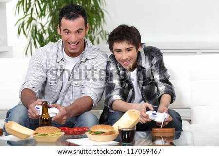 Father and son playing games together