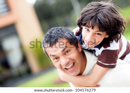 Father and son playing outdoors and having fun