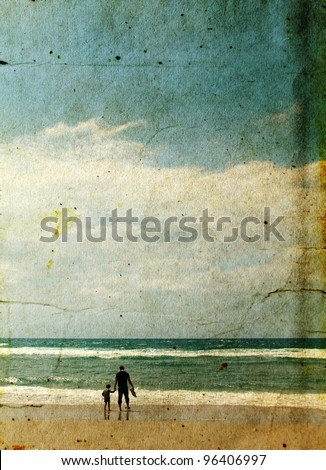 father and son playing together on the beach. Photo in old image style.