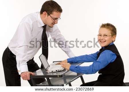 Father and son playing with laptop over white background