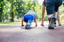 Father and son preparing to run together