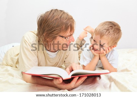 Father and son reading together