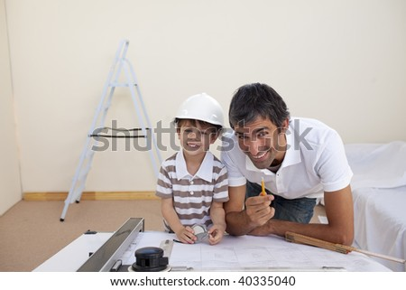 Father and son refurbishing a bedroom at home