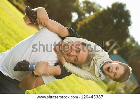 Father and son rest in the summer on the nature