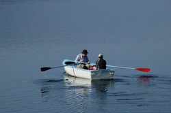 Father and son set off in their rowing boat, out on to the lake one calm sumer's morning