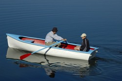 Father and son set off in their rowing boat, out on to the water one calm summer's morning