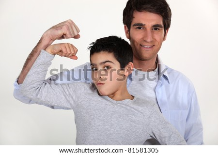father and son showing muscles