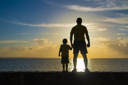 Father and son silhouette in the Amazon