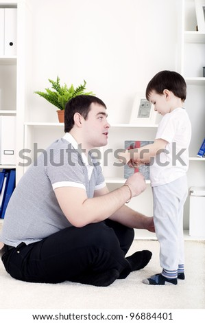 Father and son spend time together, playing at home