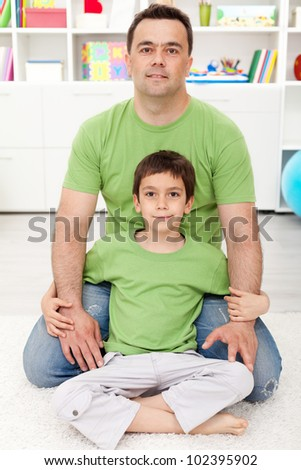 Father and son spending time together at home