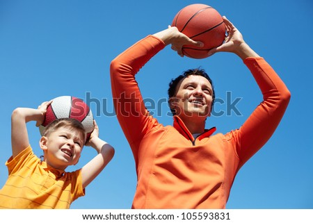 Father and son spending time together playing basketball