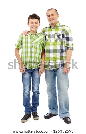 Father and son standing, isolated on white background