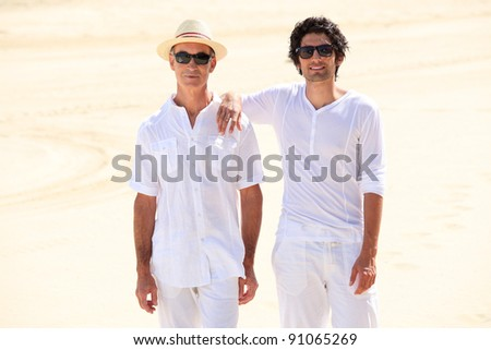 Father and son stood on beach