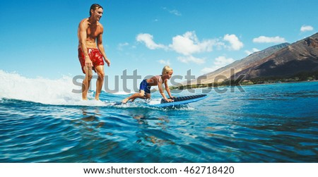 Father and son surfing together, summer lifestyle fun