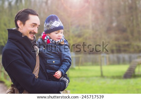 father and son taking a walk in the city park