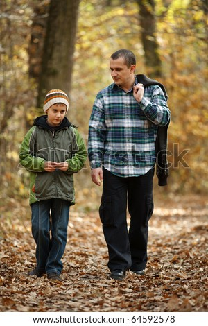 stock photo : Father and son talking a walk outdoor in a forest, in an