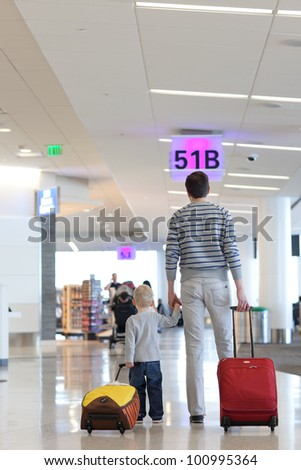 father and son together at the airport