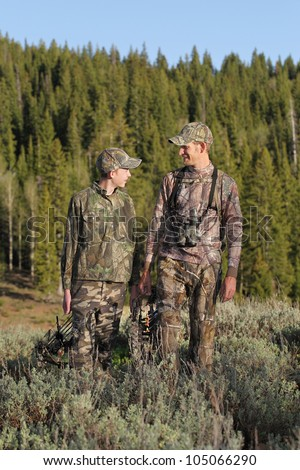 father and son together hunting together