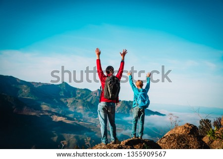 father and son travel in nature, family hiking in mountains #1355909567