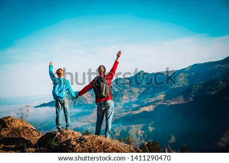 father and son travel in nature, family hiking in mountains #1411290470