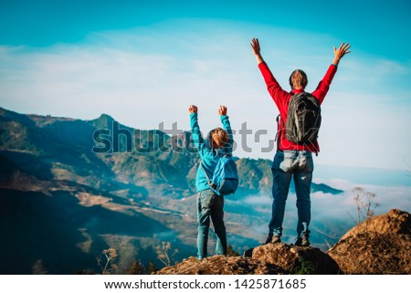 father and son travel in nature, family hiking in mountains #1425871685