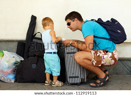 father and son travel with huge luggage