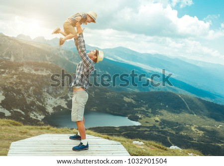 Father and son traveling in Rila mountains Bulgaria #1032901504