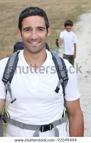 Father and son walking in countryside