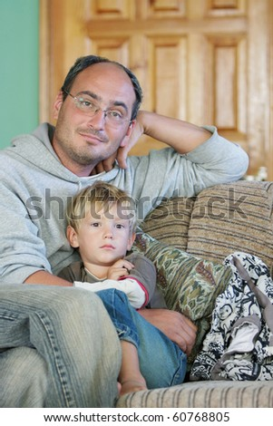 stock photo father and son watch tv at home 60768805 Sexy Cheerleader Adult Costume