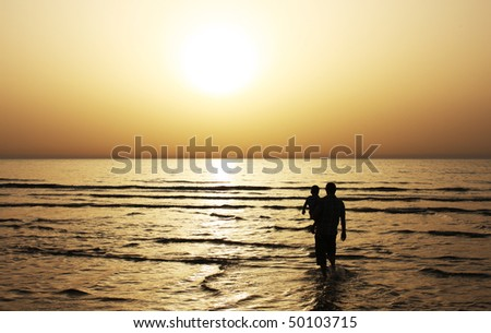 Father and son watched together at sunset