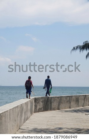 father and son went fishing in the sea on the island of thousand jakarta, indonesia Stock fotó ©